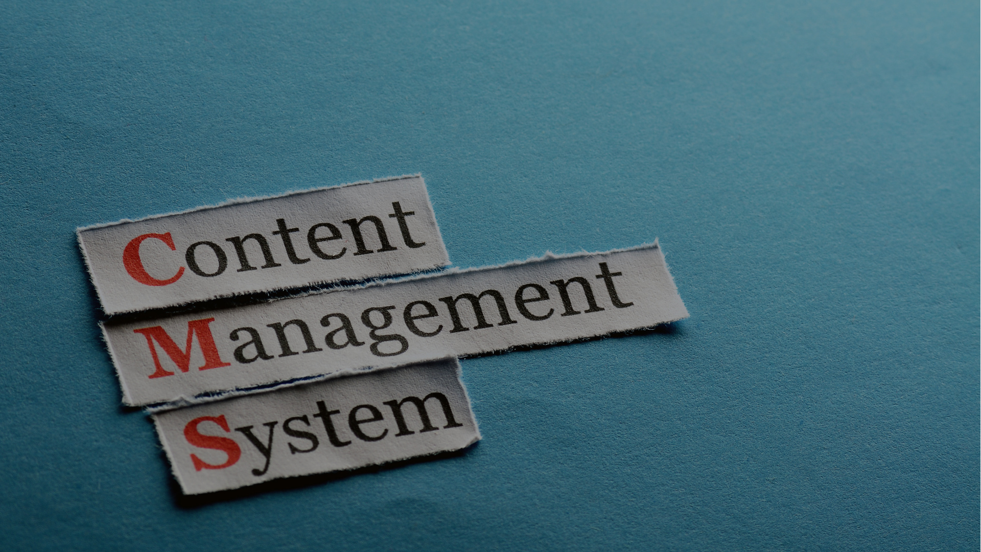 CMS Content Management System abbreviation on blue paper